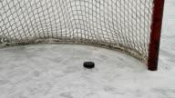 Hockey pucks slide into empty net video