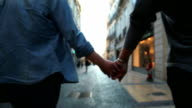 Holding hands, two woman video