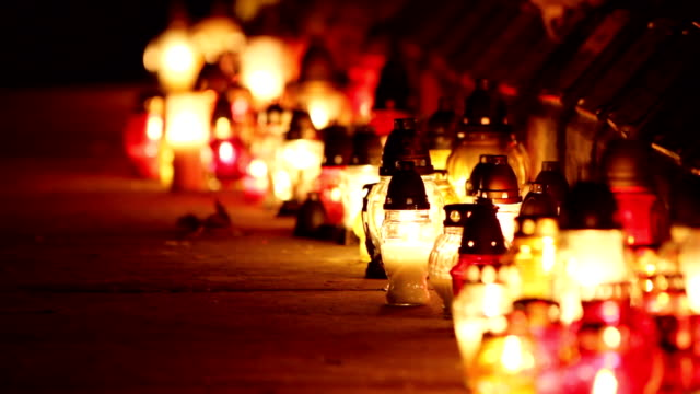 Holiday candle on the graveyard. video