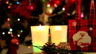 Holiday Christmas scene. Gift and candle under the Christmas tree video