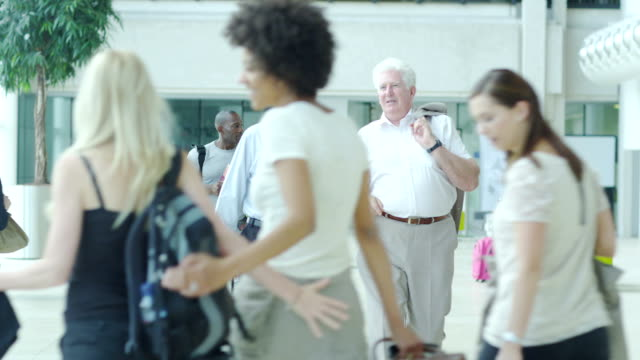 Holiday tourists in international airport video