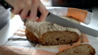 Home bread baking and slicing video
