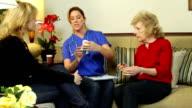Home health care nurse checking prescriptions video