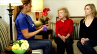 Home health care nurse giving exercise instructions video