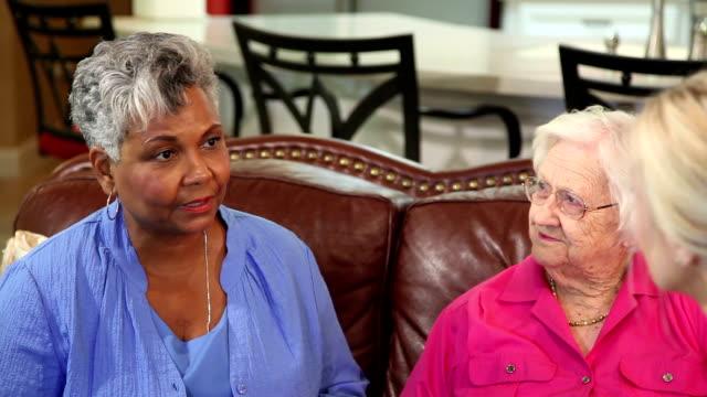 Home healthcare nurse with senior adult patients. Consulation. video