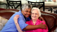 Home healthcare nurse with senior adult patients. Hugs. video