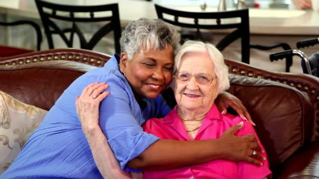 Home healthcare nurse with senior adult patients. Hugs. video