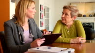 Home Healthcare Professional Using Digital Tablet video