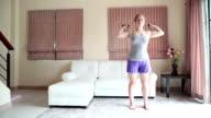 Home Workout: Natural look Woman Exercising Resistance Bands Shoulder Press video