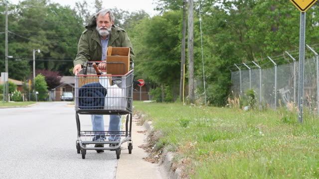 Homeless Man Pushing Cart video