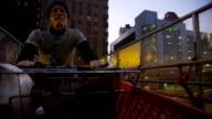 Homeless man pushing shopping cart video