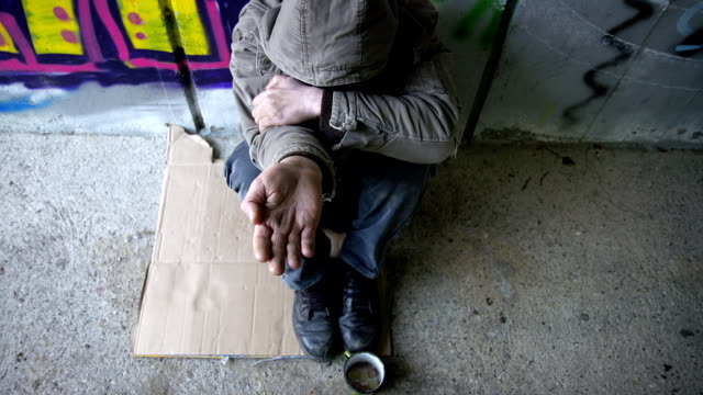 HD DOLLY: Homeless Person Holding An Open Palm video