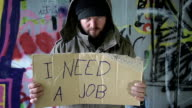 HD DOLLY: Homeless Person Looking For A Job video