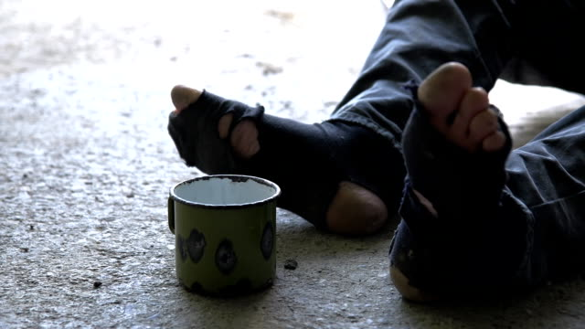 HD DOLLY: Homeless Person With Torn Socks video