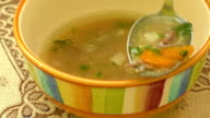 Homemade chicken soup in a bowl video