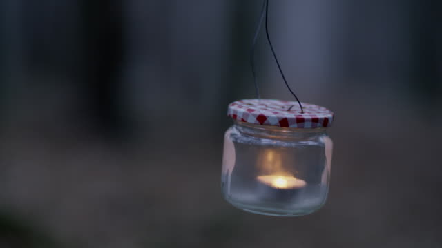 CU Homemade hand lantern against cold forest video