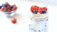 Homemade healthy yogurt with chia seeds and strawberry in jar. video