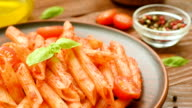 Homemade penne with tomato sauce, fresh basil and tomatoes video