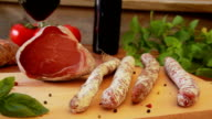 Homemade salami jerky sausages with a glass of red wine video
