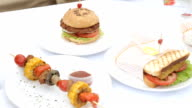 Homemade veggie burger served on wooden table. video