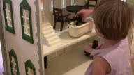 (HD1080i) Homes and Bathrooms; Child Plays with Doll in Bathtub video