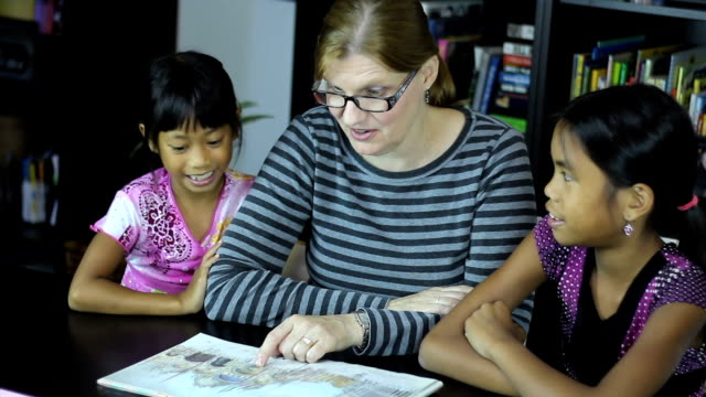 Homeschool Mom Reading To Asian Daughters During School video