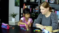 Homeschool Mom Teaching A Math Lesson With Daughter video