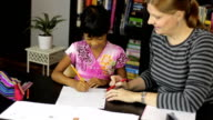 Homeschool Mom Teaching Spelling Lesson To Asian Daughter video
