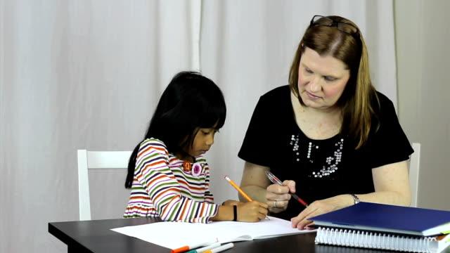 Homeschool Teacher Teaching Her Asian Daughter A Lesson video