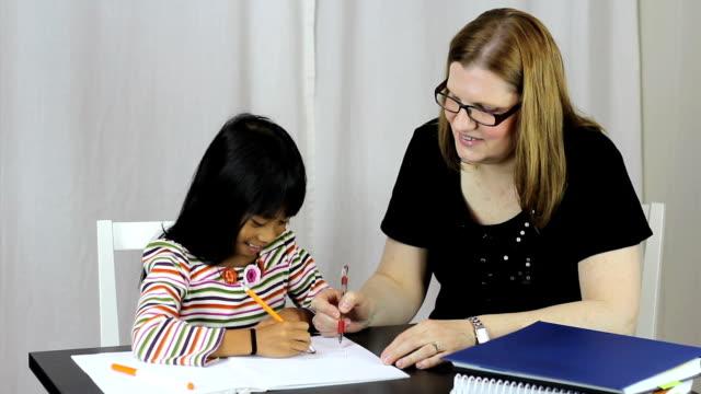 Homeschool Teacher Teaching Writing Lesson To Daughter video