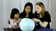 Homeschool Teacher Uses Globe To Explain Geography Lesson video