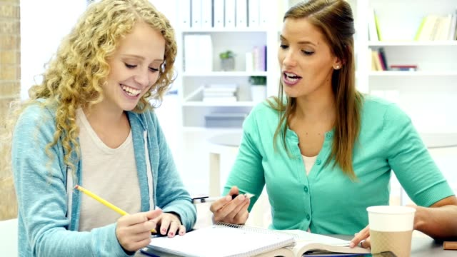 Homeschooling mom encourages daughter during assignment video
