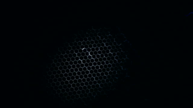 Honeycomb pattern with lighting effect over the dark background video