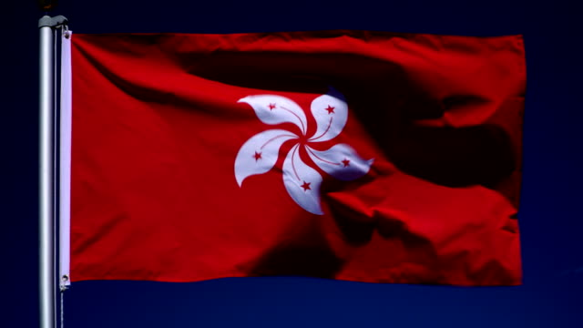 4K: Hong Kong Flag on Flagpole in front of Blue Sky outdoors video