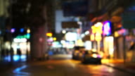 Hong Kong night street blurred video of city signs and transportations video