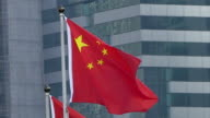 hong kong regional flag and China flag in the wind with building in hongkong.4k video