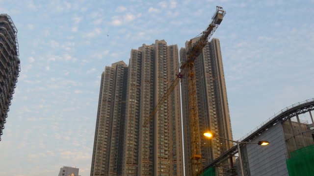 hong kong sunset time working construction crane hotel panorama 4k china video