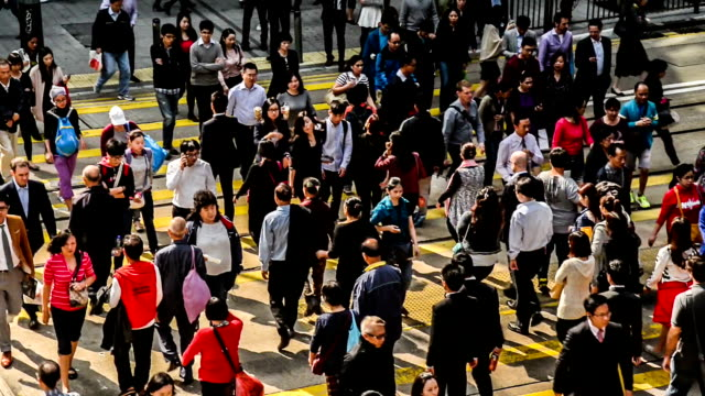 Hong Kong,China-Nov 14,2014: The pedestrians cross the street at the downtown of Hong Kong,China video