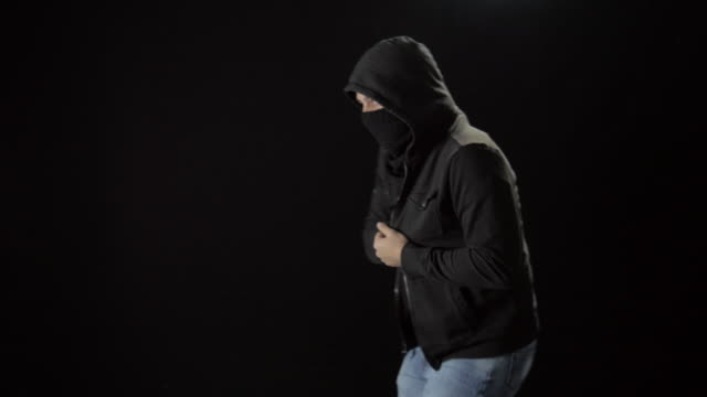 Hooded Masked Man Pulls Handgun Out of His Sweatshirt video