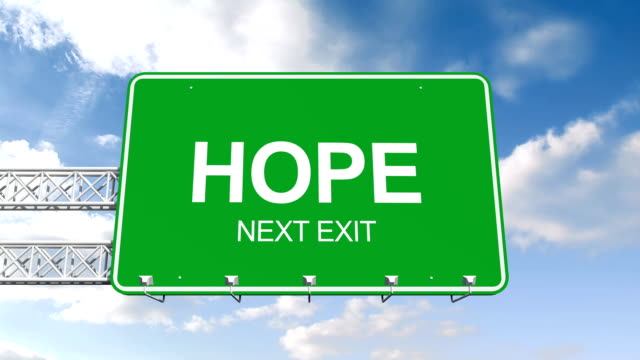 Hope next exit sign against blue sky video