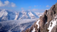 Horizontal panorama of wide mountain range in winter. Hills covered video