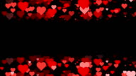 Horizontal Rows of scrolling Hearts over Black Background (Loopable) video