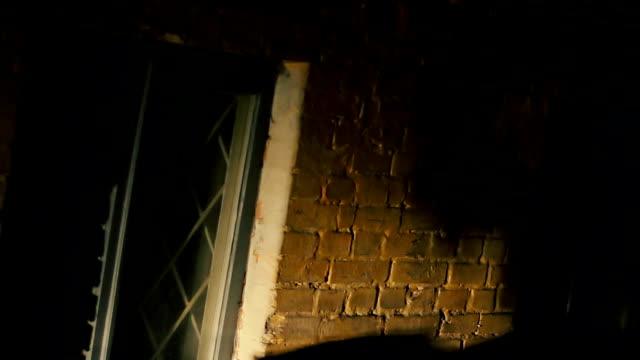 Horror film, dark shadow of killer beating victim with murder video