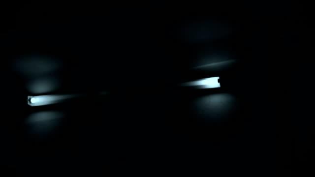 Horror movie scene, frightening darkness, flashlight on stairway video