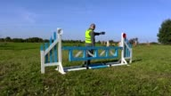 Horse handler take picture of hurdle video