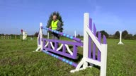 Horse handler try to fix hurdle video