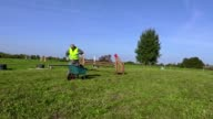 Horse handler with wheelbarrow on hurdle field video
