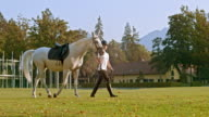 SLO MO Rider walking horse in front of riding school video