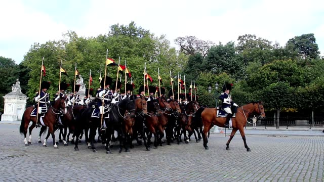 Horsemen squad in traditional Belgium uniform on Royal parade. Beautiful shot of Europe, culture and landscapes. Traveling sightseeing, tourist views landmarks of Belgium. World travel, west European trip cityscape, outdoor shot video