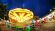 Horses Carousel in motion, in an amusement park. video